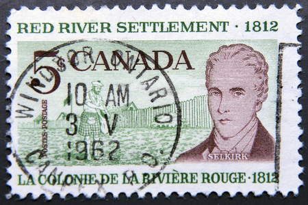settler: CANADA - CIRCA 1962: a postage stamp ofe Canada shows Scottish Settler and Lord Selkirk, 150th Anniversary of the Red River Settlement in Western Canada Editorial