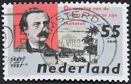 harmonie: GRANADA, SPAIN - NOVEMBER 30, 2015: stamp printed in Netherlands shows Eduard Douwes Dekker and The Harmonie Club, Batavia, circa 1987
