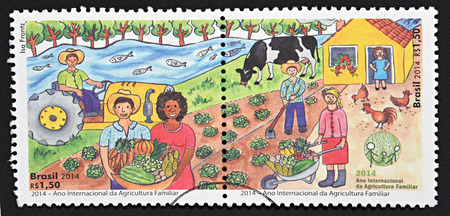 philatelist: GRANADA, SPAIN - DECEMBER 1, 2015: Stamps printed in Brazil dedicated to international year of family farming, 2014