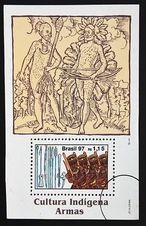 indigenous culture: GRANADA, SPAIN - DECEMBER 16, 2015: A stamp printed in Brazil dedicated to indigenous culture, weapons, 1997 Editorial