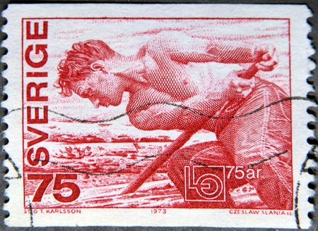 seminude: SWEDEN - CIRCA 1973: A postage stamp of Sweden shows a Worker