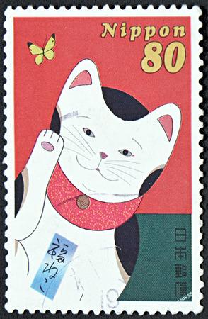 maneki: GRANADA, SPAIN - NOVEMBER 30, 2015: A A stamp printed in Japan shows a Cat, Maneki Neko Love, circa 2000 Editorial