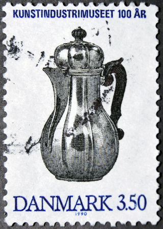 johannes: GRANADA, SPAIN - NOVEMBER 15, 2015:   A stamp printed in Denmark shows Silver coffee pot designed by Axel Johannes Kroyer, 1990