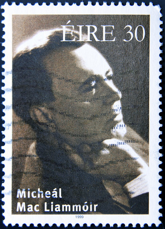 dramatist: IRELAND - CIRCA 1999: A postage stamp of Ireland shows image of Micheal Mac Liammoir,  Irish actor, dramatist, impresario, writer, poet and painter