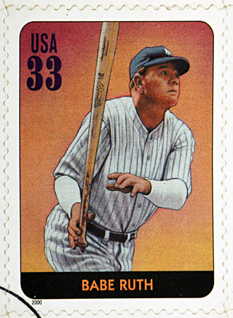 yankees: GRANADA, SPAIN - DECEMBER 1, 2015: A stamp printed in USA dedicated to Legends of Baseball shows Babe Ruth, 2000 Editorial