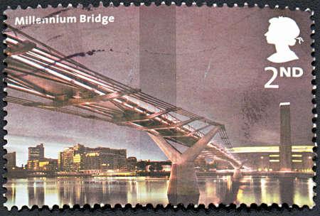 millennium bridge: GRANADA, SPAIN - NOVEMBER 30, 2015: A  stamp printed in England shows Millennium bridge at night, circa 1999