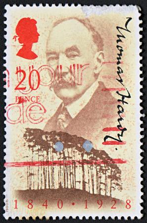 biographer: GRANADA, SPAIN - NOVEMBER 30, 2015: A stamp printed in England shows Christopher Hibbert, 1990