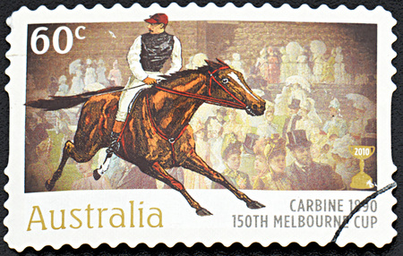 onlooker: GRANADA, SPAIN - NOVEMBER 30, 2015: A Stamp printed in Australia shows the Carbine, 1890 Winner, 150th Melbourne Cup issue, 2010
