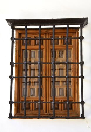 balcony window: Wooden window with a grille