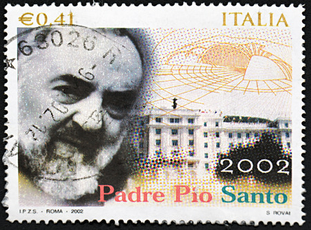 GRANADA, SPAIN - NOVEMBER 30, 2015: A stamp printed in Italy shows Pio of Pietrelcina , 2002 Imagens - 53489868