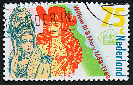 coronation: GRANADA, SPAIN - NOVEMBER 30, 2015: A stamp printed in Netherlands shows Coronation of William III and Mary Stuart, King and Queen of England, 1988