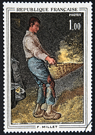 postes: GRANADA, SPAIN - NOVEMBER 30, 2015: A stamp printed in France shows young man working by Millet, 1971