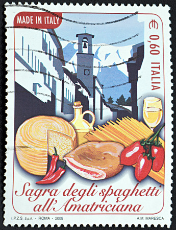 ROMA, ITALY - JANUARY 15, 2016: A stamp printed in Roma shows  Italian street in mountains with traditional food on foreground