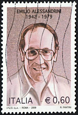 GRANADA, SPAIN - NOVEMBER 30, 2015: A stamp printed in Rome shows portrait of Emilio Alessandrini, 2009