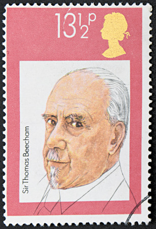 thomas: GRANADA, SPAIN - NOVEMBER 30, 2015: A stamp printed in England shows portrait of Sir Thomas Beecham, circa 1995 Editorial