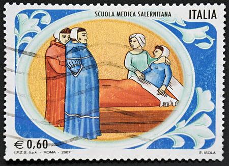 medical school: GRANADA, SPAIN - NOVEMBER 30, 2015: A stamp printed in Rome shows four women in medical school, 2007