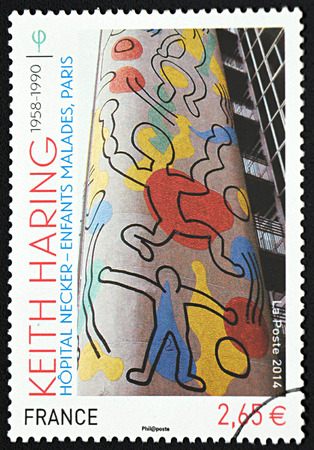 keith: GRANADA, SPAIN - NOVEMBER 30, 2015: A stamp printed in France shows wall of childrens hospital, 2014