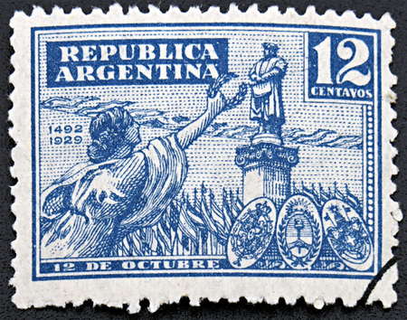 GRANADA, SPAIN - NOVEMBER 30, 2015: A stamp printed in Argentina shows woman holding wreath against of statue of famous person, 1929