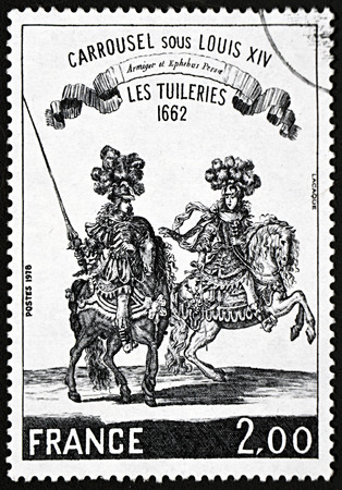 postes: GRANADA, SPAIN - NOVEMBER 30, 2015: A stamp printed in France shows man and woman riding horses in beautiful clothes, 1978