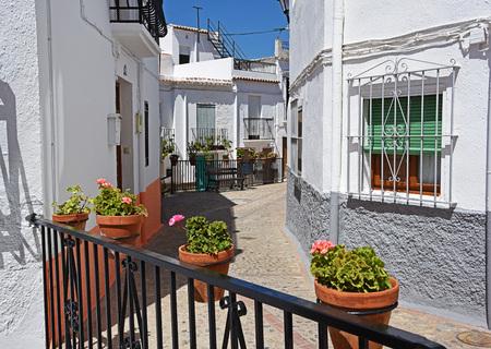 alpujarra: Street with flower pots in facades. Village in the Alpujarra Stock Photo