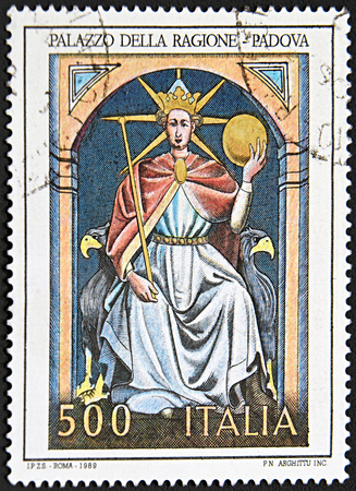 sceptre: GRANADA, SPAIN - NOVEMBER 30, 2015: A stamp printed in Rome shows queen sitting on throne holding sceptre, Palace of Reason - Padua, 1989