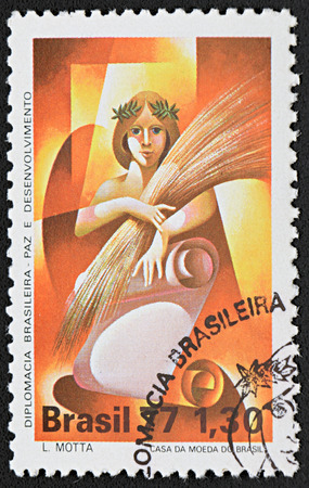 GRANADA, SPAIN - NOVEMBER 30, 2015: a stamp printed in Brazil shows Woman Holding Sheaf, 1977 Editorial