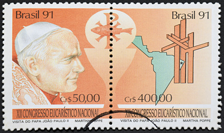 beatification: GRANADA, SPAIN - NOVEMBER 30, 2015: a stamp printed in Brazil showing an image of pope John Paul II, 1991.