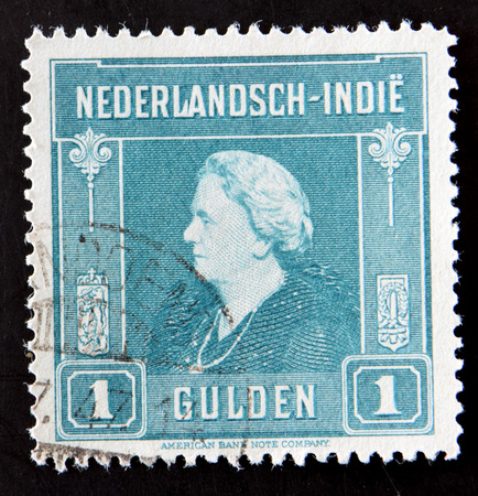 GRANADA, SPAIN - MAY 15, 2016: A stamp printed in the Netherlands Indies shows image of Queen Wilhelmina of the Netherlands, circa 1945 Editorial