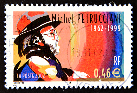 GRANADA, SPAIN - MAY 15, 2016: A stamp printed in France shows portrait of famous French jazz pianist Michel Petrucciani, 2002