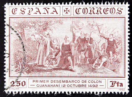 cristobal colon: GRANADA, SPAIN - MAY 15, 2016: stamp printed in Spain shows first landing of Columbus, Guanahani October 12, 1492, 1992 Editorial