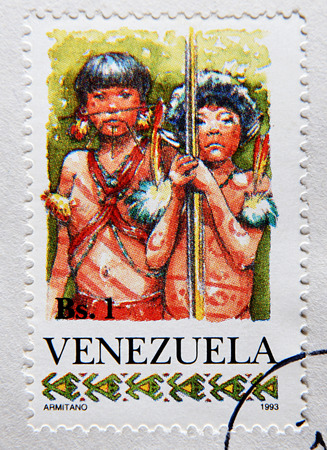 GRANADA, SPAIN - MAY 15, 2016: Stamp printed in Venezuela shows Two Yanomami Children, circa 1993 Editorial