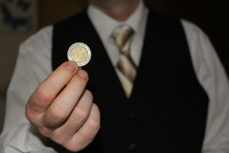 man hand holding a coins, finance concept, counting