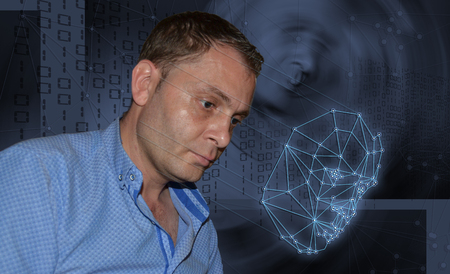 Biometric verification - young man face recognition concept Stock Photo