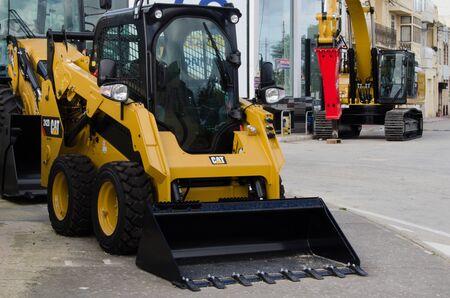 Burmarrad, Malta, 15 december 2018 - small lifter Excavator in the machinery store
