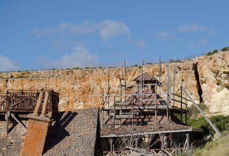 Mellieha, Malta, 30 december 2018 - Rough house in Popeye village movie set, construction works Anchor bay