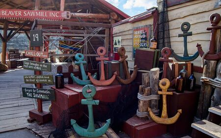Mellieha, Malta, 30 december 2018 - Small colorfull anchors in front of beaver sawmill in Popeye Village Anchor bay