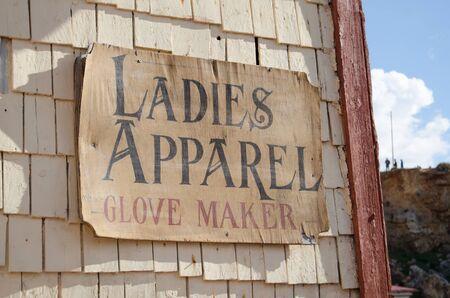 Mellieha, Malta, 30 december 2018 - Ladies apparel sign on wooden house in Popeye Village Anchor bay 報道画像