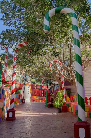 Mellieha, Malta, 30 december 2018 - Colorfull candy city for children in Popeye village movie set post office house entrance and candyes Anchor bay