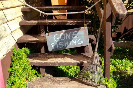 Mellieha, Malta, 30 december 2018 - Gone fishing sign on the stairs on the entrance of the Olive's in Popeye village Anchor bay
