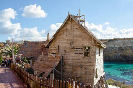 Mellieha, Malta, 30 december 2018 - Rough house old wooden broken houses in Popeye village Anchor bay 報道画像
