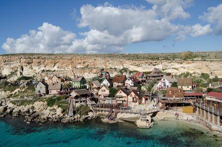 Mellieha, Malta 30 december 2018 - Wooden colorful houses in Popeye Village movie set Anchor bay 報道画像