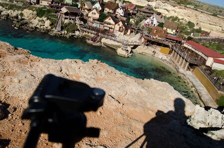 Mellieha , Malta, 30 december 2018 Photographer seting up equipment over popeye village anchor bay 報道画像
