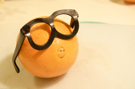 one orange with glasses, smart orange, organic food choise.