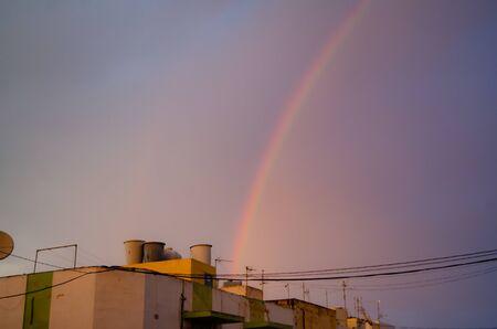 Qawra, Malta 30. may 2019 - rainbow over the residential buildings