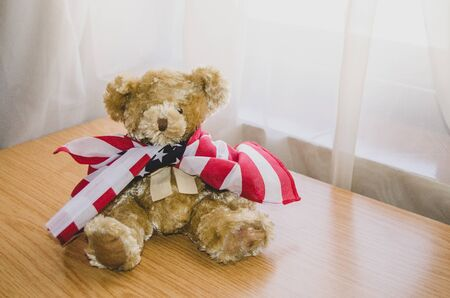 little teddy bear with USA flag - happy memorial day