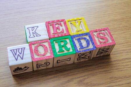 Educational toy cubes with letters organised to display word KEYWORDS - editing metadata and Search engine optimisation concept 写真素材