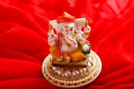 Ganesha Festival, Lord Ganesha statue on colorful background Stock fotó