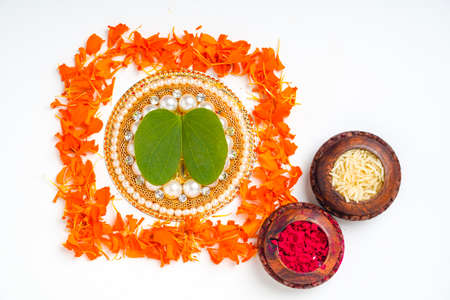 Happy Dussehra greeting card , green apta leaf and rice, Indian festival dussehra Stock Photo