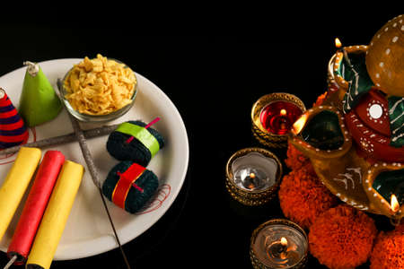 fire crackers,lamp and flower on dark background , Indian festival Diwali