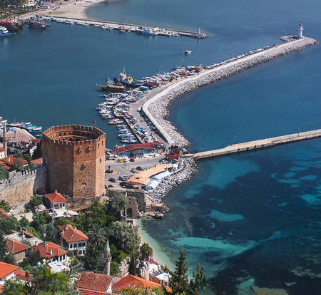 old ship: Alanya Hystorical Red Tower and Lighthouse Stock Photo